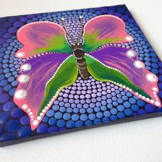 An Original Butterfly mandala painting on canvas painted with dotart style :) Size of the painting is 15cm x 15cm. My art will be carefully packaged to ensure painting reaches you in perfect condition. The item will be sent with Priority Air Mail. I cant take responsibility for any lost, damaged, or delayed pieces by fault of postal services. I cannot refund these pieces untill the items return back to my adress. I cant resend replacements because these are original handmade works of art…
