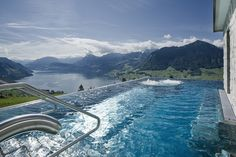 HOTEL VILLA HONEGG, SWITZERLAND This over 100-year-old 5-star Swiss villa located high on Mount Burgenstock contains some picturesque views of Lake Lucerne which can be enjoyed from the resort's large heated mountaintop infinity pool. The hotel also includes 23 luxury rooms, a private movies theatre and a relaxing spa and wellness centre.