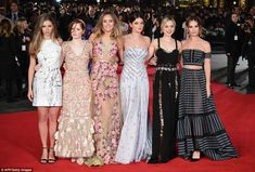Leading ladies: (L-R) Hermione Corfield,  Ellie Bamber,  Suki, Millie Brady, Bella Heathcote and Lily James all teamed up for a glamorous shot