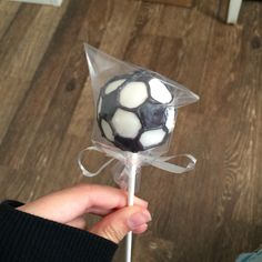 Soccer ball cake pops. White and black candy melts to decorate.