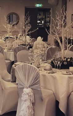 Winter wedding wonderland with manzita tree centrepieces and foliage. White and silver table settings
