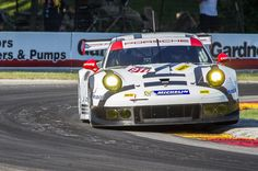 Hard Apex - The Porsche North America team 911 RSR of Richard Lietz pounds the apex of turn 6 at Road America.
