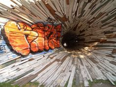 2005  -- --  Outside of Houston and prior to demolition, two homes were given to Dan Havel and Dean Ruck who converted them into a giant vortex that exited through a small hole into a quiet courtyard next door.  For contrast see pin: http://pinterest.com/pin/131026670378879706/