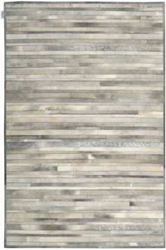 PRA1 SIL - Columbus Ohio Rugs - Azia Rugs. The Calvin Klein Prairie Collection is a hand stitched leather cowhide rug. Available in other colors and sizes.