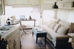 One of the best renos I've seen.  Life As An Artistpreneur: Our 5th Wheel RV Renovation Reveal! The Glamper!