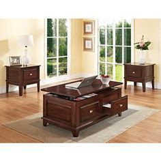 Add elegant function to a room with the Mahir Lift Top Coffee Table. This piece features a lift top and drawers. Tapered feet and a beautiful walnut finish add style. This coffee table with drawers will work well with just about any decor