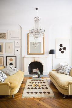 Ali Cayne's West Village townhouse, shot by Brittany Ambridge (for Domino?). Yellow sofas!