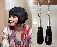 Inspired by Phryne Fisher, a female sleuth who sashays through the back lanes and jazz clubs of late 1920s Melbourne, fighting injustice with her pearl-handled pistol and her dagger-sharp wit, these earrings feature-  faceted black onyx glass teardrop crystals sterling silver bead caps silver plated leverback earring hooks 2 1/4 inches in length