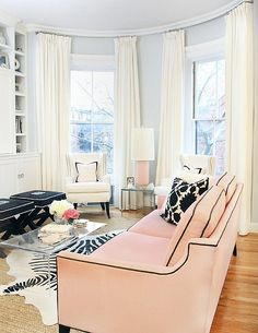 Love everything about this room! Especially the pale pink sofa!
