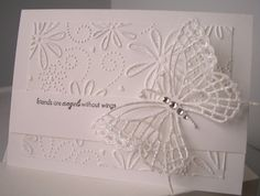 So, so pretty.  Love the white on white and the gorgeous butterfly!