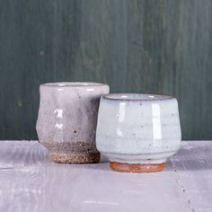 Some recent 'one gulp' cups. The left guinomi has been decorated with slip (liquid clay) which I've wiped through with my fingers. I've added rough materials to the clay to bring out texture and feeling in the surface and used a thin coating of glaze to preserve the more austere feeling in the clay. It can be a bit rough on the hands but I think it's worth it :) The right guinomi is decorated with a nuka type glaze which used wood ash as a flux. The white colour comes from a surplus of…
