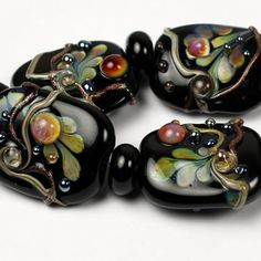 Hey, I found this really awesome Etsy listing at https://www.etsy.com/listing/204710061/sra-black-lampwork-glass-bead-set