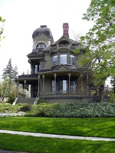 Kind of a cool, somber-looking Victorian.  Congrats on a superb looking yard, too!
