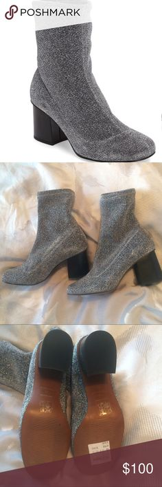 "Topshop Martha Glitter Sock Bootie silver 8.5 cute A sparkly bootie that pulls on like your favorite thick sock is a comfortable way to rock the block-heel-bootie trend. 2 1/2"" heel (size 37) 6"" shaft Stretch-fabric upper; pull-on style Textile upper and lining/synthetic sole Flared block heel Made in Spain BP. Shoes Topshop Shoes Ankle Boots & Booties"