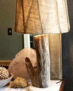 Make a simple lamp from a driftwood log.
