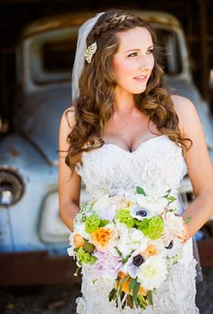 Brides.com: Wedding Hairstyles that Work Well with Veils. A Side Braid Wedding Hairstyle with Loose Curls. Add some bohemian flair with a braided crown and long, loose tresses. This bride's veil peeks out from behind a old-fashioned broach, proving it doesn't need to be the main event.   Browse more long wedding hairstyles.