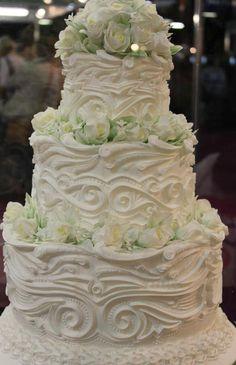 Pretty White Swirls & Mint Green Flowers Wedding Cake