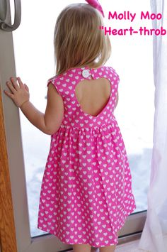Super cute  Molly Moo valentines dress!  Heart cut out in back  https://www.facebook.com/mollymoobowtique