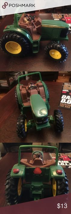 Official John Deere Tractor-Heavy duty&well made! In great condition even after our boys played with it! Extremely well made classic! Great in the sandbox/in a pile of dirt. Perfect size not too big/small.Thick Rubber wheels that turn. Boys ❤️. Ertl John Deere Official Toy Maker Other
