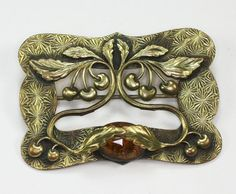 Antique Art Nouveau sash pin or brooch has an elaborate applied design of cherries and leaves draping gracefully from upper to lower portion of the