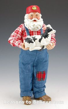 Santa with Black and White Calf--Farmer Santa Claus holding a black and white newborn calf. This artistic and collectible Fabriche Santa Claus figure is carefully made from a combination of stiffened fabric, fabric mache, and resin. Gift boxed.