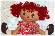 Oh Sew Dollin's How to make curly yarn doll hair for a handmade rag doll.