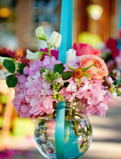 gorgeous Spring wedding flowers Like the idea of hang flower with ribbon
