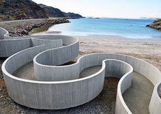 This snaking concrete ramp winds down from a road to the beach along the edge of the Arctic Ocean