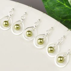 Looking for a beautiful fall color for your bridesmaid jewelry?  Sage green pearl infinity earrings are all sterling silver with swarovski pearls.  Perfect for your bridesmaid earrings.  Pearl Bridesmaid Earrings Set OF 6  15% OFF by MyDistinctDesigns