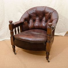 English Victorian Tufted Leather Barrel Back Open Armchair   From a unique collection of antique and modern armchairs at https://www.1stdibs.com/furniture/seating/armchairs/