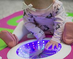 Munchkin Galaxy Play Mat is the only play mat that bursts to life with just a tap! 10 sequences of LED light shows entertain your baby while 9 soft foam tiles provides 14 square feet of play space.