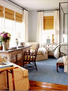 Bamboo shades with curtains, pretty grey-blue walls, rustic desk. Gorgeous bedroom!