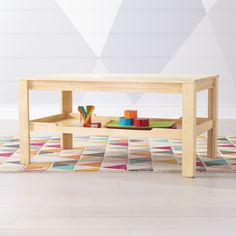 Shop Large Natural Adjustable Kids Table Storage Tray. Take organization to new heights with this storage tray. Designed for use with our Large Adjustable Play Table, the tray can be attached to add an additional level of storage.