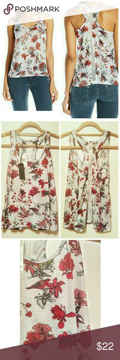 S,M,L,XL Buffalo DB Floral & Bird Racerback w Lace This airy, lightweight tank is so beautiful! The floral pattern incorporates different birds, and looks like watercolor painting on an ink drawing. The colors are reddish fuchsia to medium pink with pops of muted lime green, printed on heather gray fabric. There is also a gorgeous white lace panel running down the center of the back. The fabric is 100% polyester jersey, the lace is 100% nylon. Buffalo David Bitton Tops Tank Tops