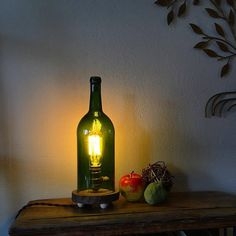 Natural rustic wood log slice wine bottle lamp with edison bulb byMillerLights