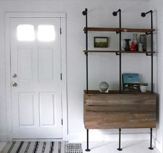 DIY media and laundry shelves made with metal pipe and wood