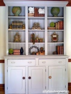 A well-styled bookcase contains an interest mix of display items carefully arranged among the books. Layering items adds depth and interest. -- Styling a Bookcase: All About Vignettes. Styling Bookshelves, Bookcase Shelves, Built In Shelves, Bookcases, Book Shelves, Shelving, Bookshelf Ideas, Built Ins, Build Shelves