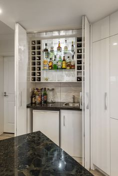 As part of the complete renovation project at this inner city penthouse apartment we designed and custom built all the c Custom Kitchen Cabinets, Custom Kitchens, Custom Cabinetry, Open Plan Apartment, Apartment Kitchen, Modern Home Bar, Modern Kitchen Design, Drinks Fridge, Game Room Bar