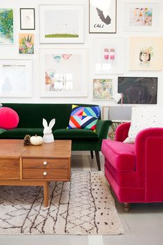 more gallery walls, plus bright pink seat and mid-century modern coffee table (via domino magazine)