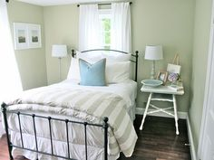 Another great example of a small guest room. Again, light colors (on the wall, bedding and curtains) would really benefit the basement.