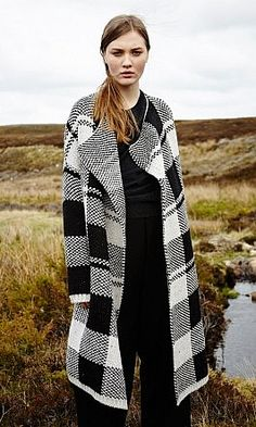 Graphic chunky knit black and white check double-faced cardigan with shawl collar and wrap-over front. 2 concealed side pockets. L108cm. 80% Wool 20% Nylon. Blanket Cardigan - Plümo Ltd