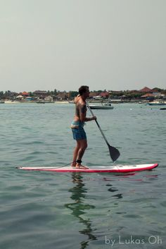 enjoying paddle surfing at Lembongan Island, Bali