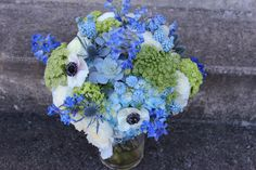 blue wedding flowers hydrangea, muscari/grape hyacinth, delphinium, succulents, queen annes lace, anemone black and white, thistle, etc. http://sophisticatedfloral.com/