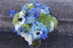 blue wedding flowers  hydrangea, muscari/grape hyacinth, delphinium, succulents, queen annes lace, anemone black and white, thistle, etc. http://sophisticatedfloral.com/