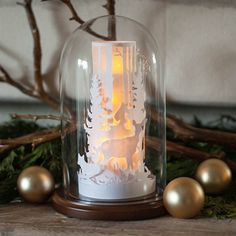 What a cute winter wonderland scene featuring trees, deer, fox and a rabbit. Add some electric tea light candles for a warm winter glow.