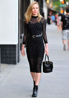 Kate Bosworth hit the streets of New Orleans in a sheer long-sleeve black midi dress from the new Kohl's k/ lab collection that features a white star print, low turtleneck, stretchy mesh overlay, and coordinating slip lining. The star teamed the piece with a leather belt that she wrapped around her waist, a pair of black patent ankle boots, and a matching bucket bag.