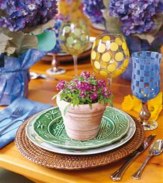 Cute table setting for spring - I would use glasses that are not quite so modern.  That match the plates better.