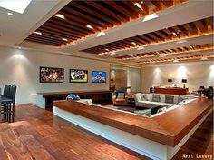 Luxurious man cave with sunk in seating to create a conversation pit. Three plasma screen TV's to make sure you don't miss a minute of any game on!