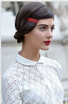 Faux side swept bangs with a bright hued barette. So sweet with a bold lip and fresh faced makeup.