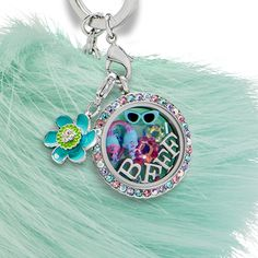 """Add the Trolls Satin and Chenille Charm to the Large Gold """"Be Colorful"""" Scallop Twist Living Locket® along with extra bling and sparkle from our Medium Rose Aurora Borealis Flower Swarovski® Crystal."""